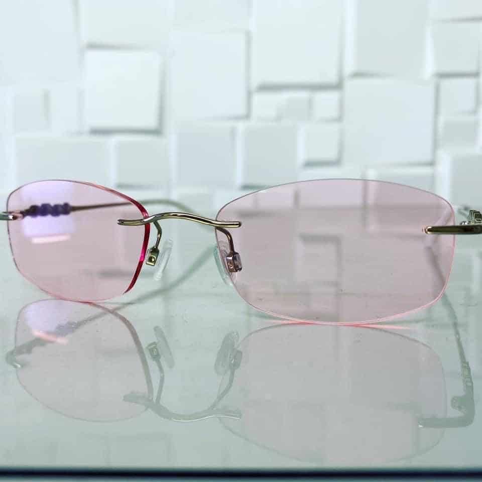 1.6 ThinLight Platinum Varifocals With Light Rose Tint And Anti Reflection Coating. Reglazed Into This Rimless Frame